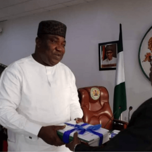 The Dean of the Faculty of Management and Social Sciences of Godfrey Okoye University, Professor Onyema Ocheoha, presents his report as Chairman of the Ad hoc Committee on  Civil Service Reform to the Governor of Enugu State, Dr. Lawrence Ifeanyi Ugwuanyi.